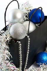 Christmas balls and tinsel in gift bag symbol of New Year isolat