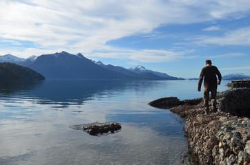 Man walking on pier in lake Nahuel Huapi, Bariloche