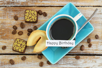 Happy birthday card with cup of coffee, fortune cookie