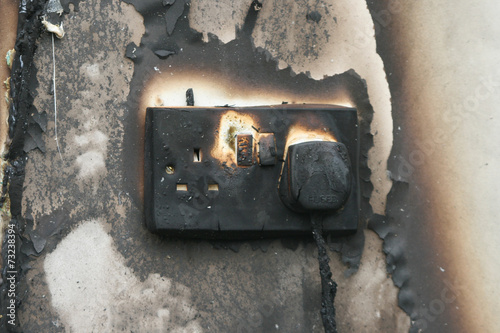 fire damaged electrical socket - 73238394