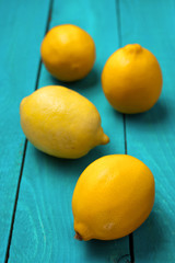 Lemons on the bright cyan background