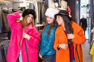 Three Women in a Clothing Store with Colorful Coats
