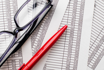 Eyeglasses and Red Pen on Top of Documents