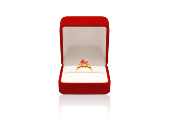 Luxury golden ring with diamond in red box on a white background