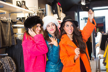 Three Women taking a Selfie Wearing Colorful Coats