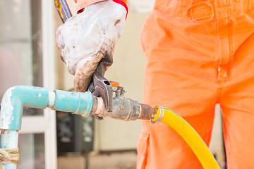 Worker man fix water system valve