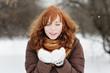 Beautiful woman having fun in winter