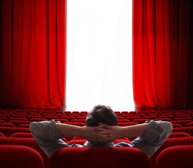 cinema screen red curtains opening for vip person