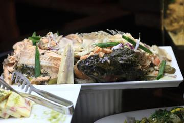 Baked fish on tray