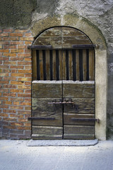 Old wooden door in Tuscany. Color image
