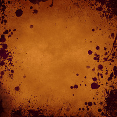 orange grunge background with splatters in the borders