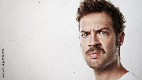 canvas print picture Portrait of an angry man with mustache