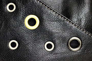 Black leather background with circle studs