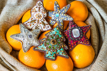Christmas tree ornaments and oranges lying in sack