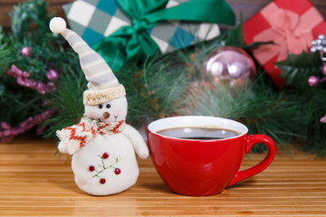 New Year composition with  snowman and cup of hot coffee