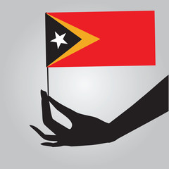 Hand flag with East Timor