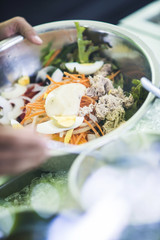 making tuna salad in bowl