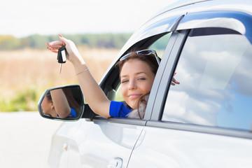 girl in a car holding keys