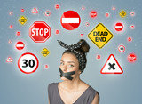 Young woman with glued mouth and traffic signals poster