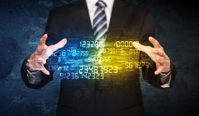 Businessman holding number cloud
