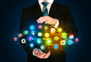 Businessman holding app icon cloud