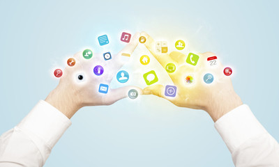 Hands creating a form with mobile app icons