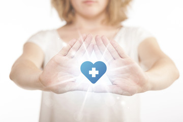 Hands creating a form with heart blue cross