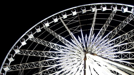 The white ferris wheel in twilight. Time lapse.