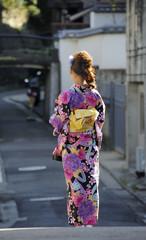 Geisha walking at the street