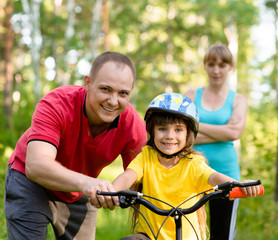 Family on cycle ride In forest