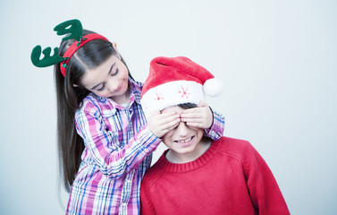 Happy sister and brother celebrating Christmas at home. Children