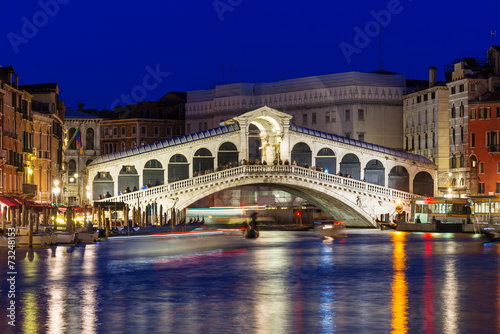 Night view of Rialto bridge and Grand Canal in Venice. Italy