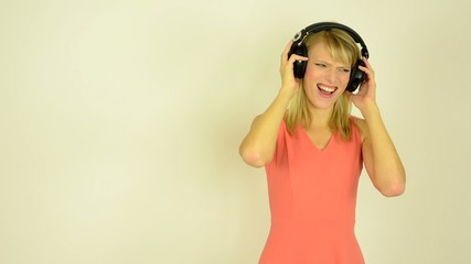 woman listens horrible music with headphones - horrible music