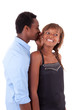 African American young couple sharing a secret - Black people