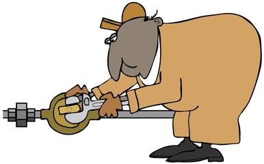 Plumber turning a valve