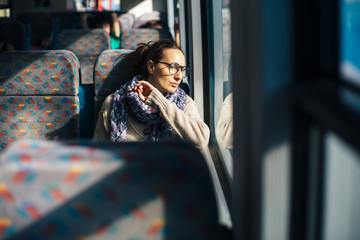 Pensive woman traveling by train bus