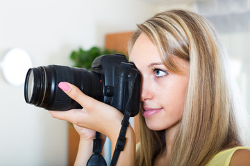 Camerawoman taking images indoor