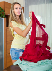 Girl choosing curtains for interior