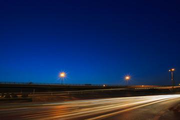 lighting of vehicle driving on asphalt road against beautiful bl