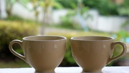 Hot Steaming Coffee in Two Cups Outdoors - Breakfast in Summer.