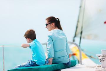 Family sailing on luxury yacht