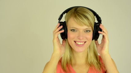 woman listens to music - woman takes on headphone
