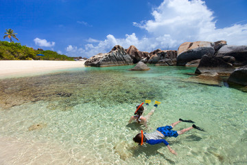 Family snorkeling at tropical water