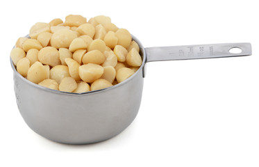 Macadamia nuts in a cup measure