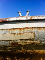 Rusty hull of an old fishing boat.