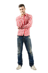 Worried standing man looking down isolated