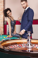 Couple playing roulette at casino