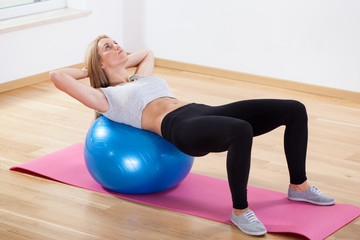 Abs training on fitness ball