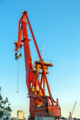 Industrial crane against blue sky