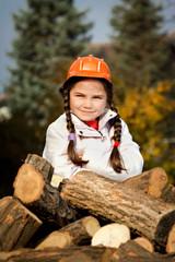Children helping stack firewood